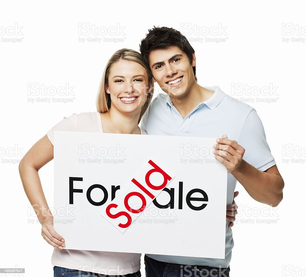 Young Couple With a New Home - Isolated royalty-free stock photo