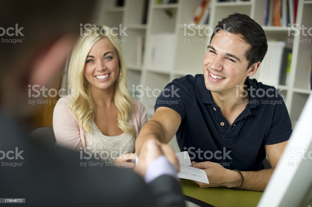 young couple with advisor royalty-free stock photo