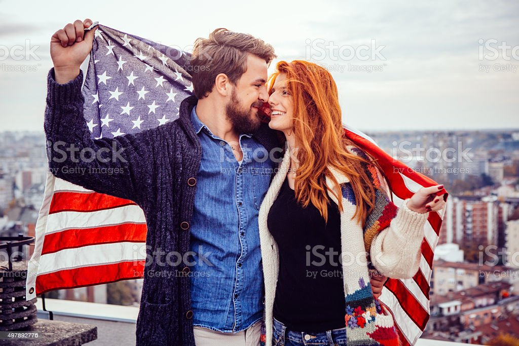 Young couple with American flag. stock photo