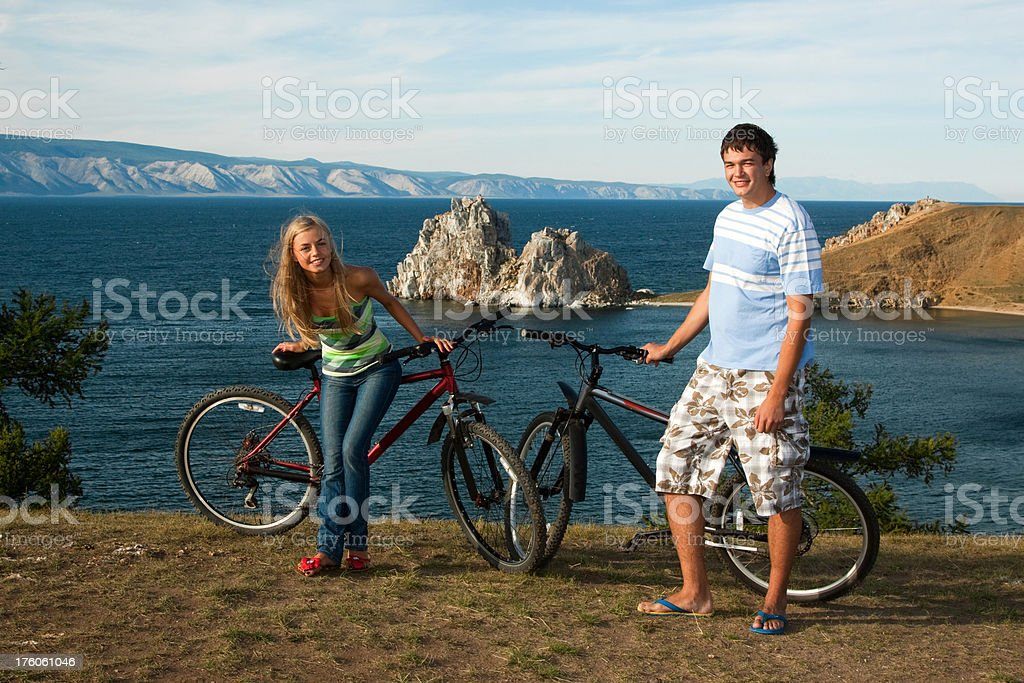 Young couple with bicycles on the lake royalty-free stock photo