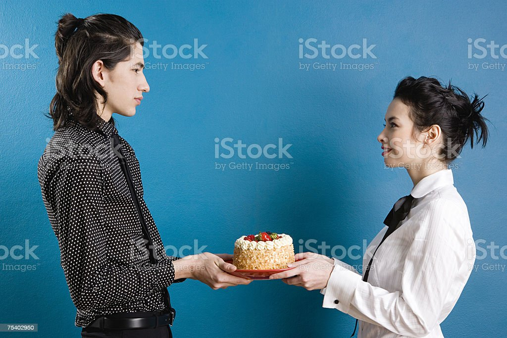 Young couple with cake stock photo