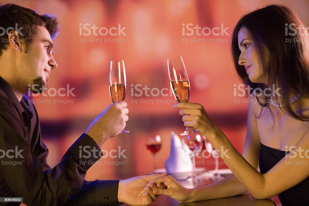 Young couple with champagne glasses in restaurant royalty-free stock photo