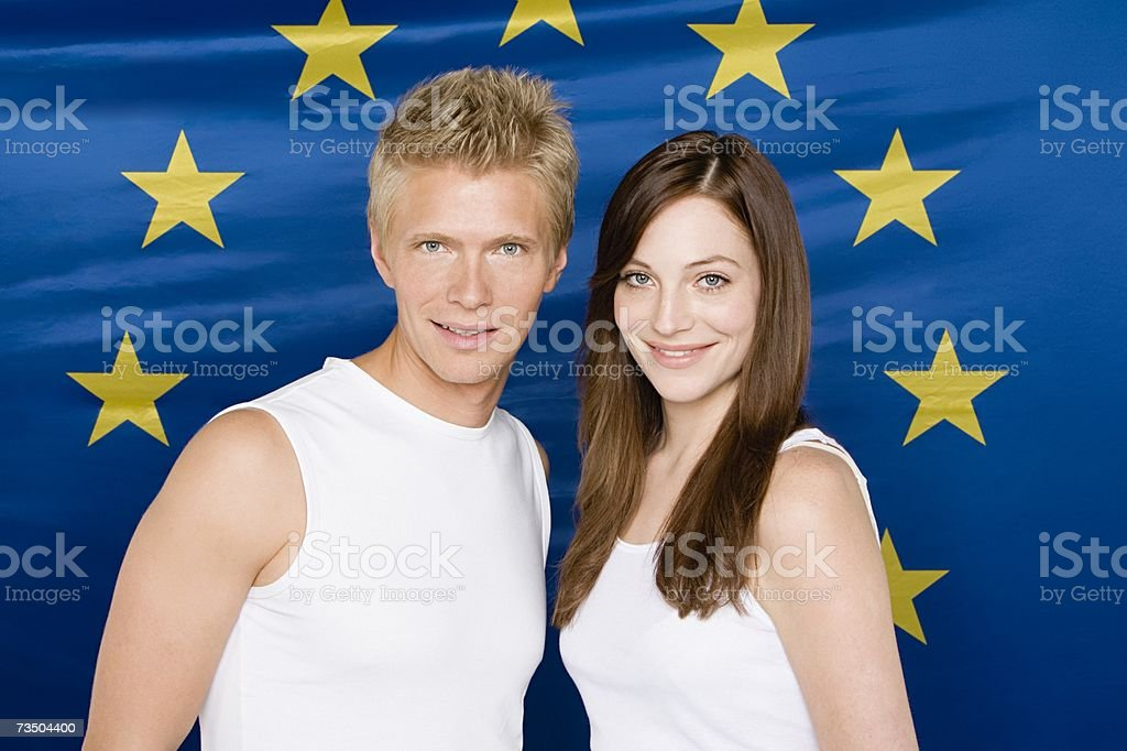 Young couple with european community flag stock photo