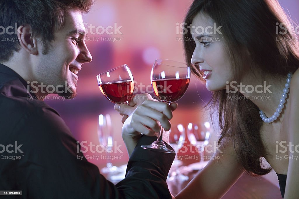 Young couple with glasses of red wine in restaurant royalty-free stock photo
