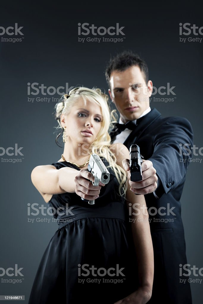 Young Couple With Gun royalty-free stock photo