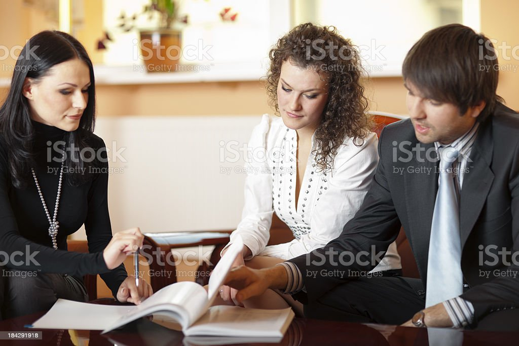 Young Couple With Insurance Agent royalty-free stock photo