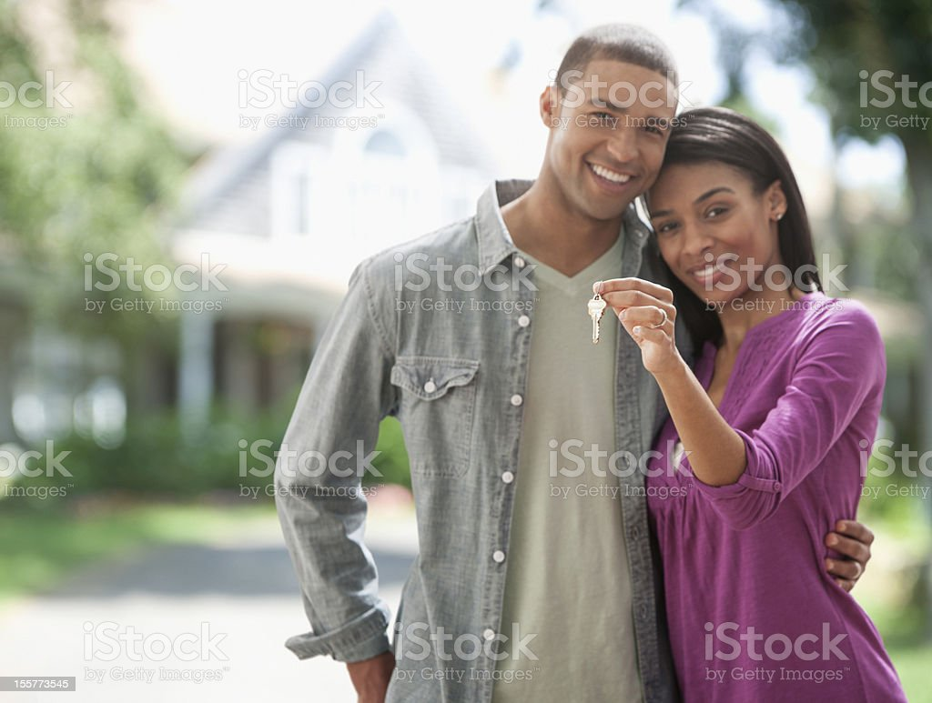 Young couple with keys to new home stock photo