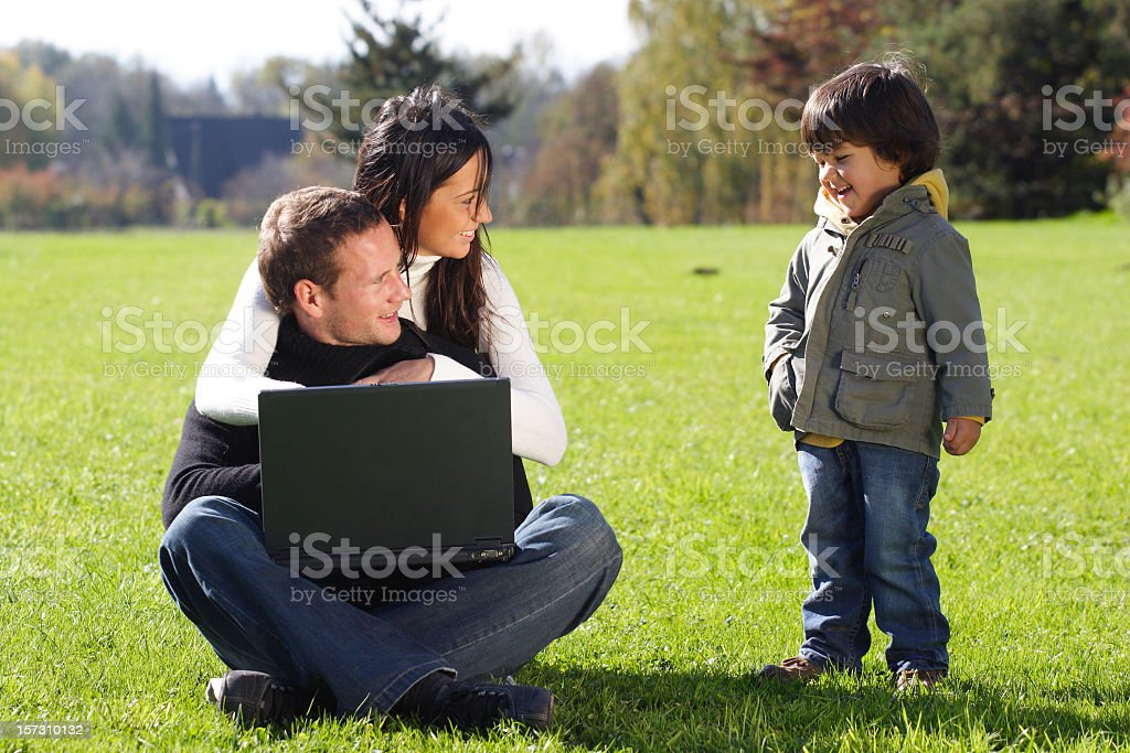 Young couple with kid stock photo