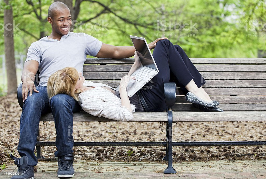 Young Couple with Laptop in City Park royalty-free stock photo