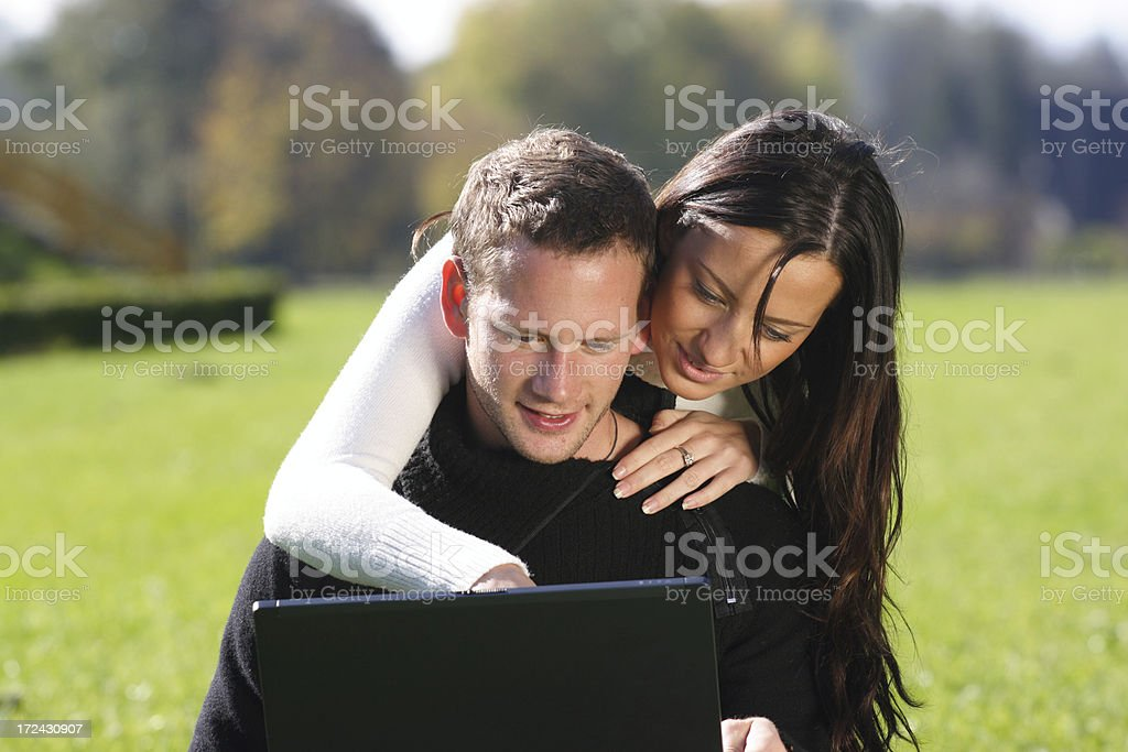 Young couple with laptop royalty-free stock photo