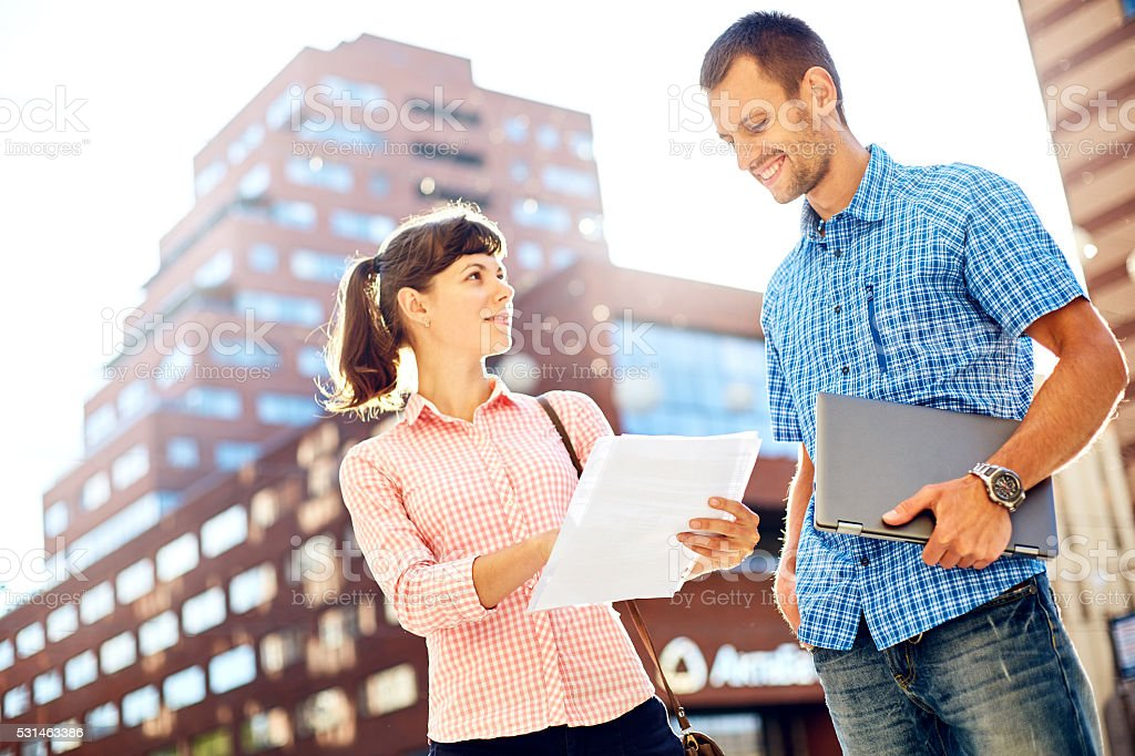 young couple with laptop stock photo