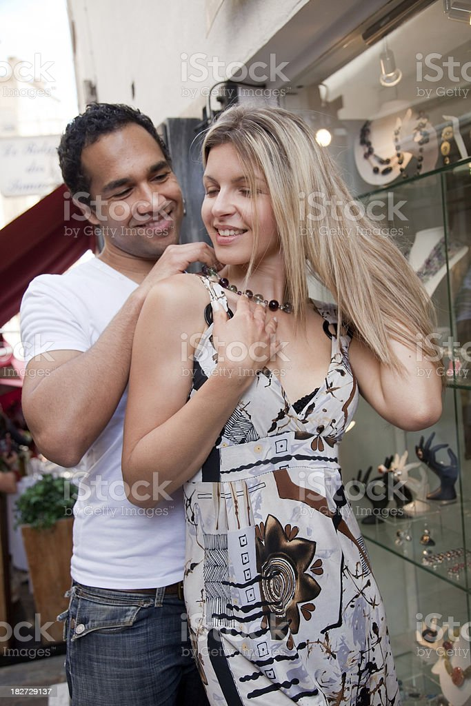 Young couple with man giving woman a necklace stock photo