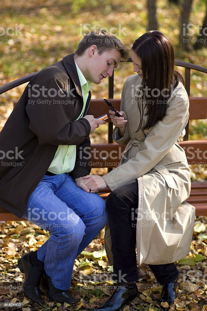 Young couple with mobile phones royalty-free stock photo
