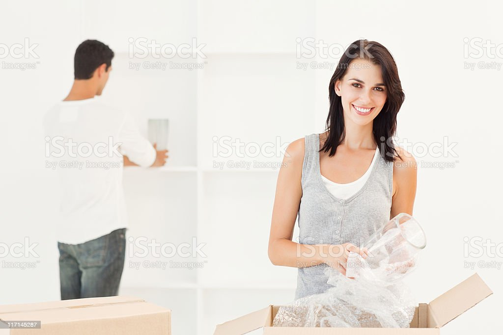 Young Couple With Moving Boxes royalty-free stock photo