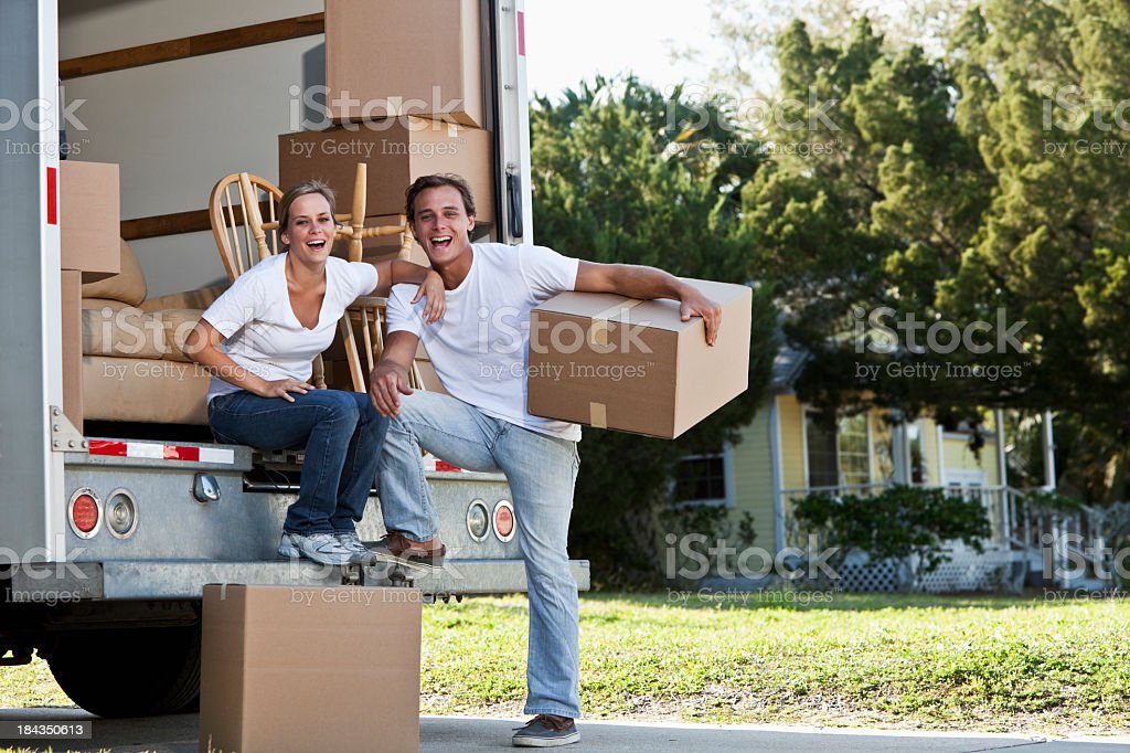 Young couple with moving van stock photo