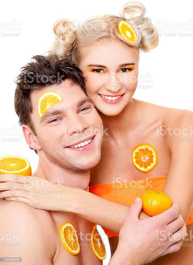 young couple with oranges royalty-free stock photo
