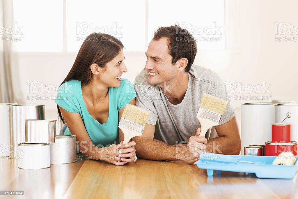 Young Couple With Paint Brushes And Cans royalty-free stock photo