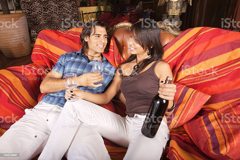 Young couple with red wine stock photo