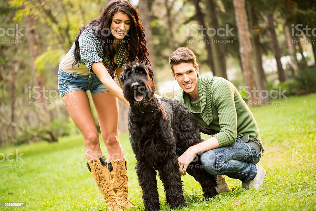 Young Couple With Schnauzer stock photo