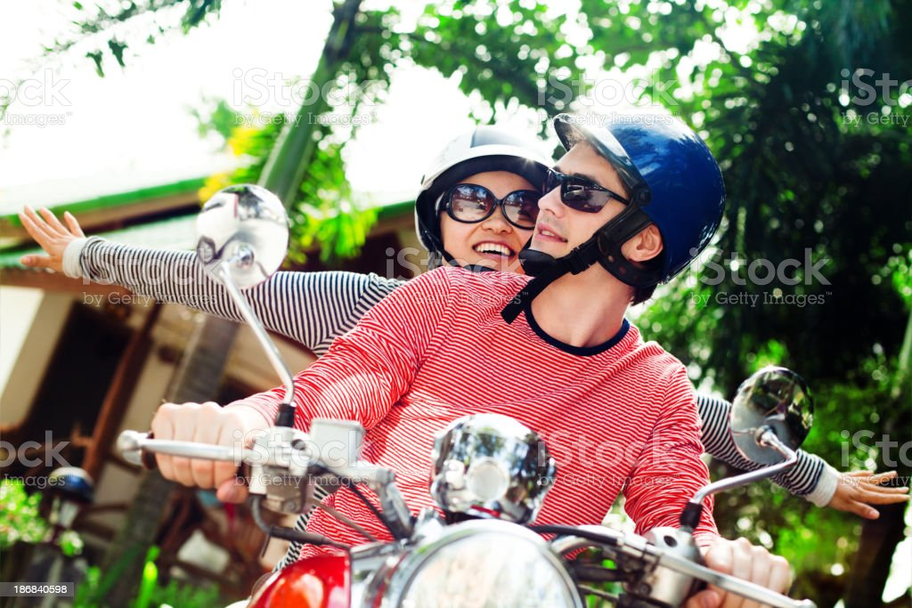 Young couple with scooter royalty-free stock photo