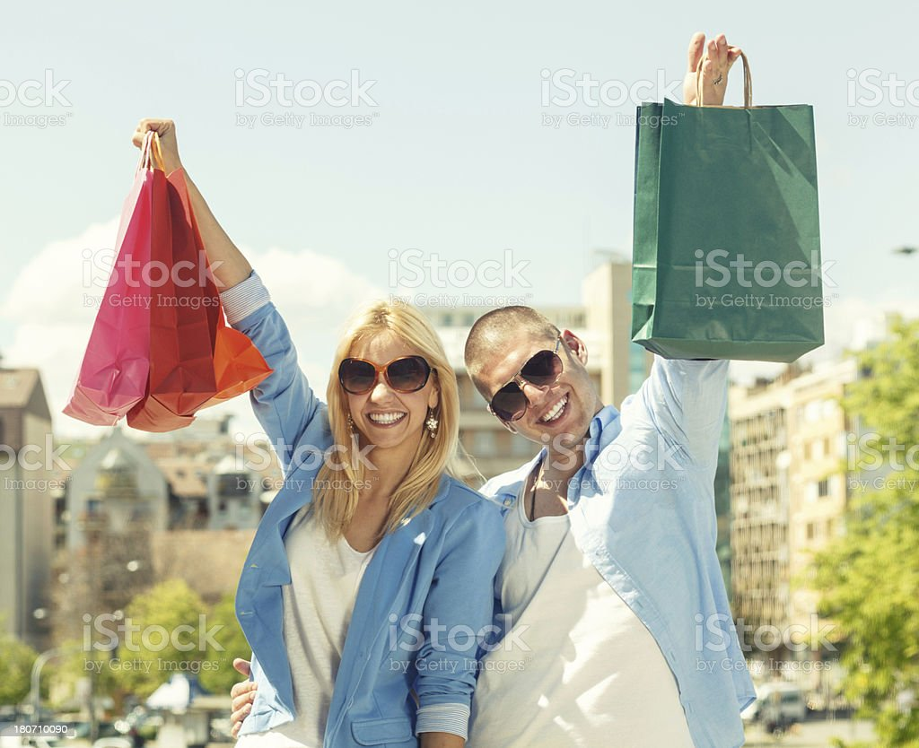 Young couple with shopping bags royalty-free stock photo
