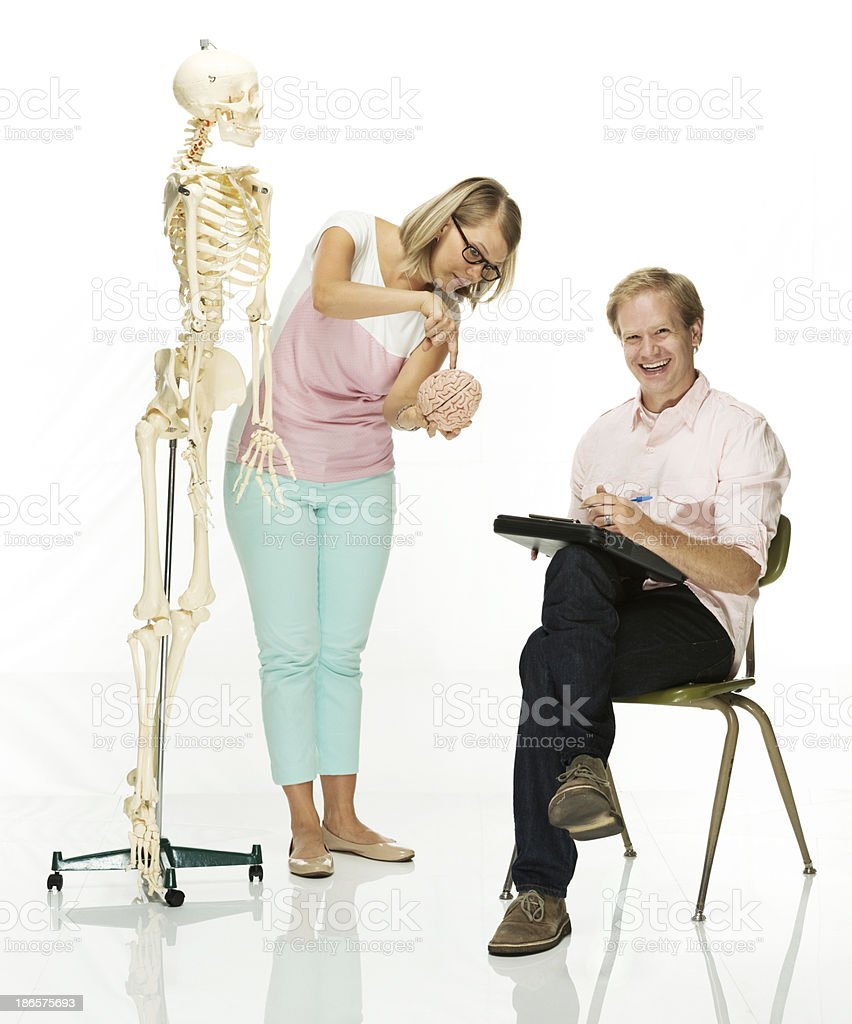 Young couple with skeleton and human brain royalty-free stock photo