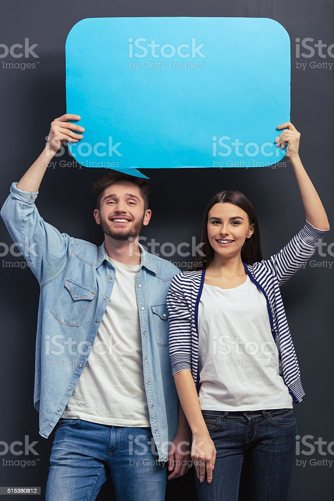 Young couple with speech bubbles stock photo