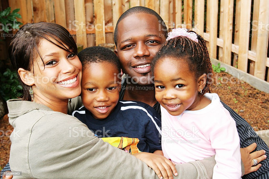 Young Couple with Two Little Kids stock photo