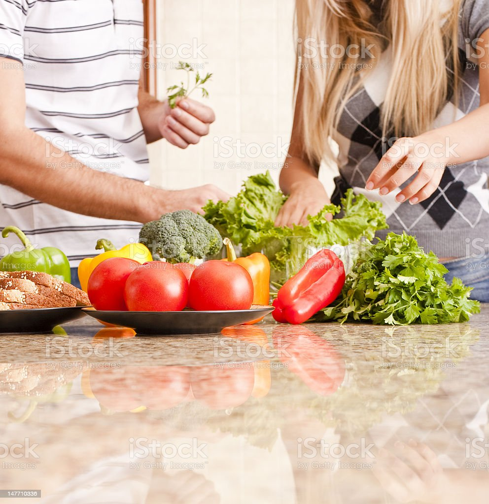 Young Couple with Vegetables royalty-free stock photo