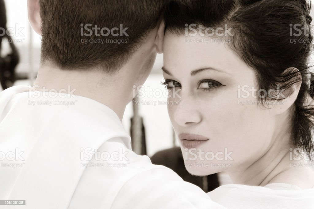 Young Couple, Woman Looking Over Shoulder royalty-free stock photo