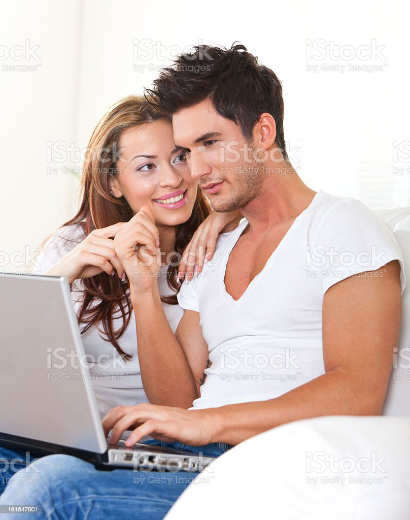 Young Couple Working On Laptop Indoors royalty-free stock photo