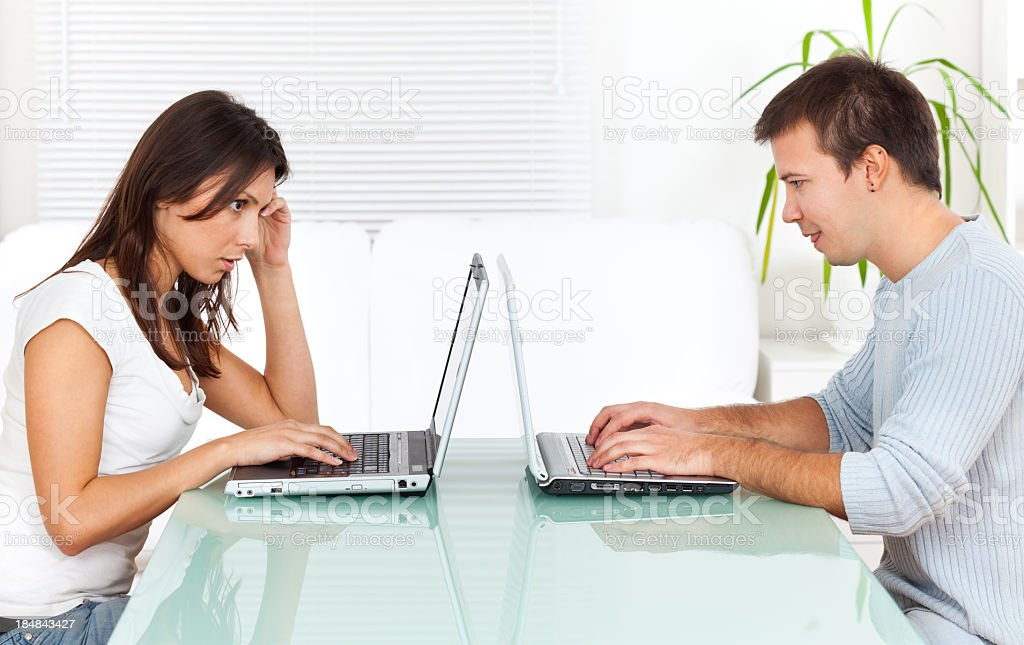 Young couple working on laptops royalty-free stock photo