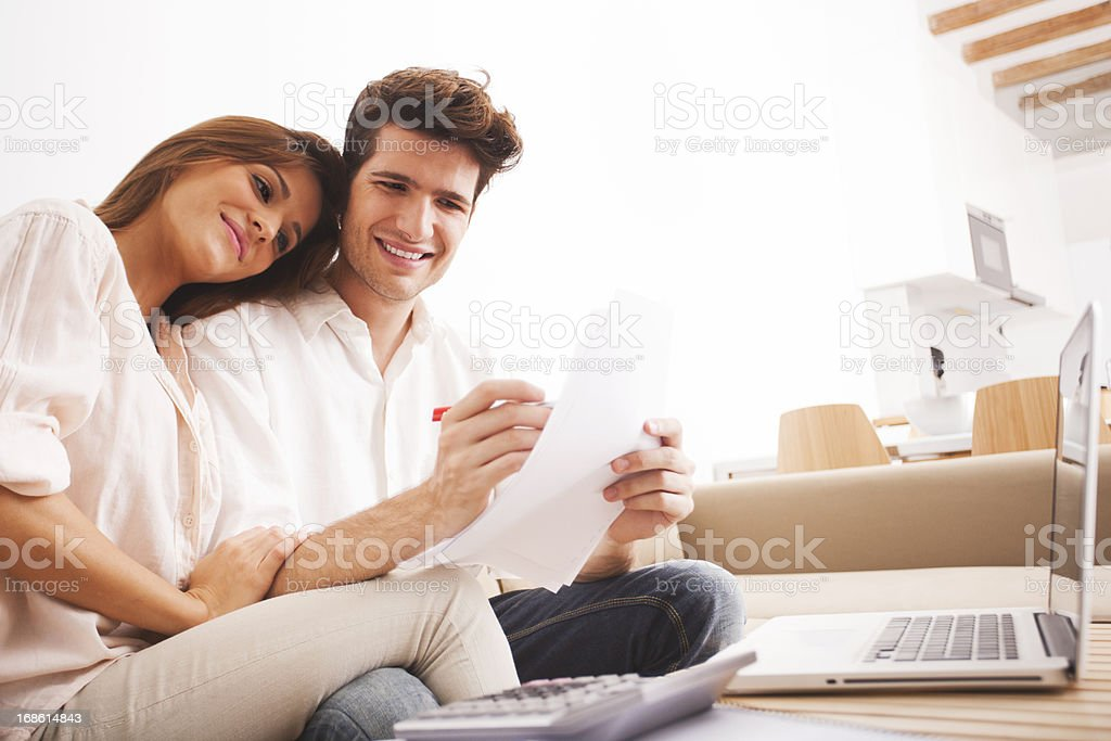 Young couple working on their domestic finances. stock photo