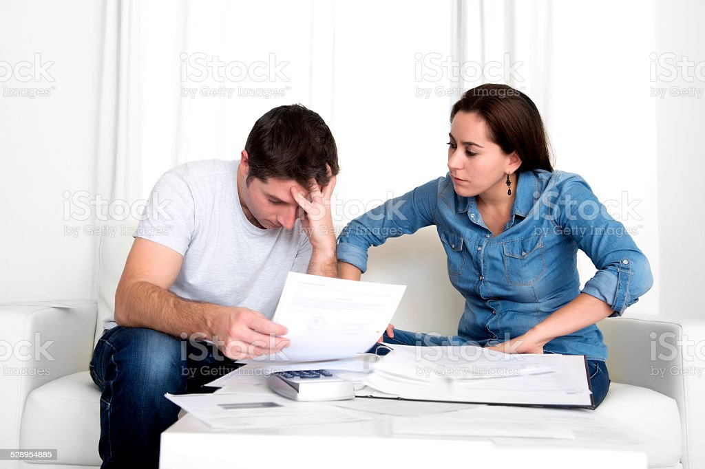 young couple worried at home in stress accounting bank payments stock photo