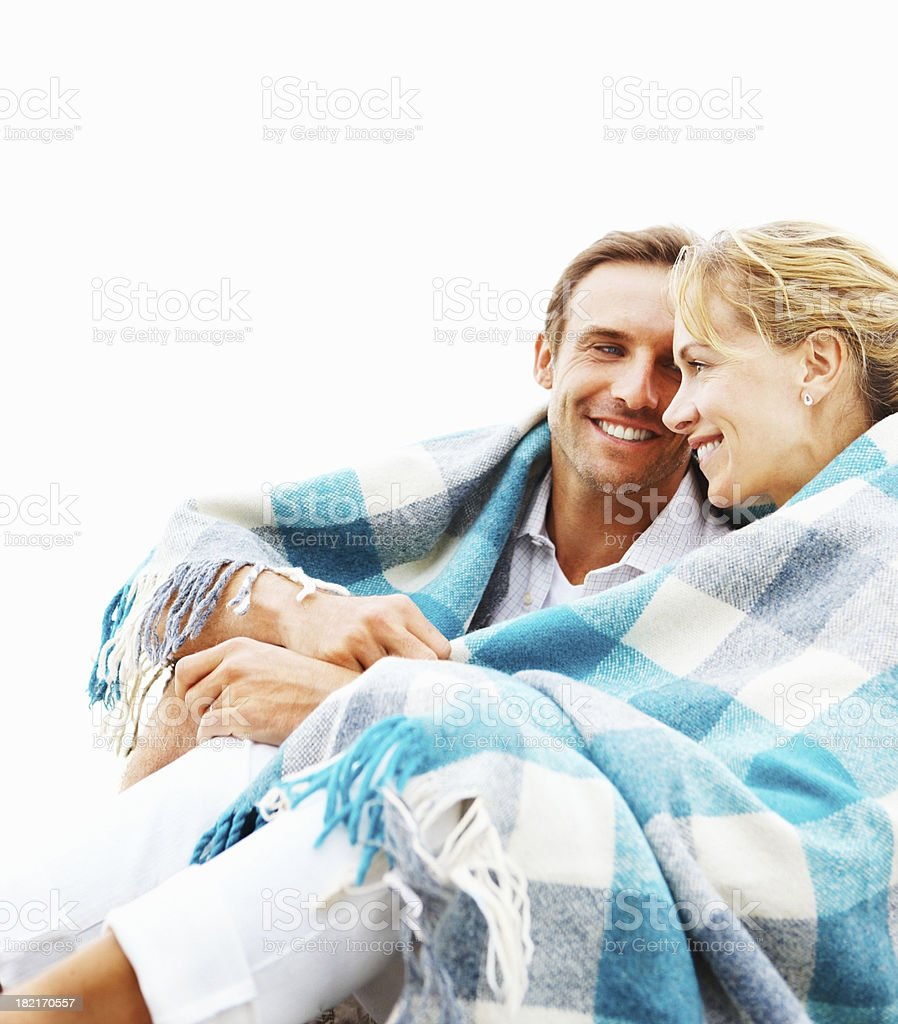 Young couple wrapped in a blanket royalty-free stock photo