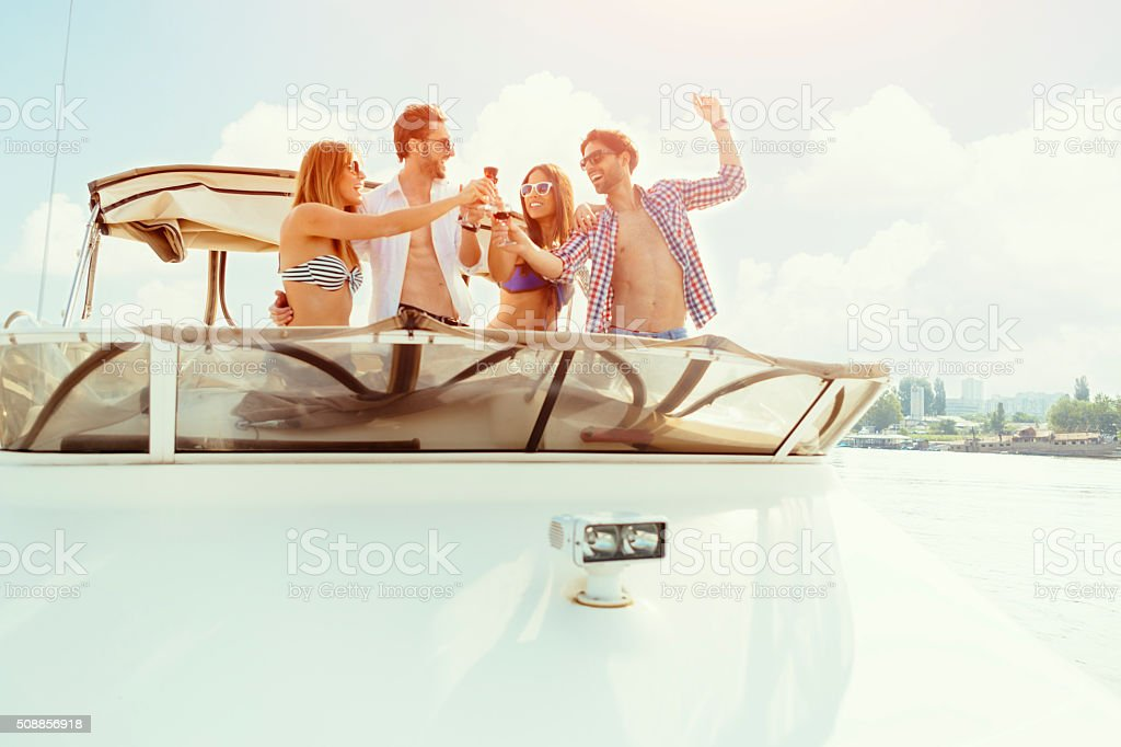 Young Couples Drinking Wine On Yacht. stock photo