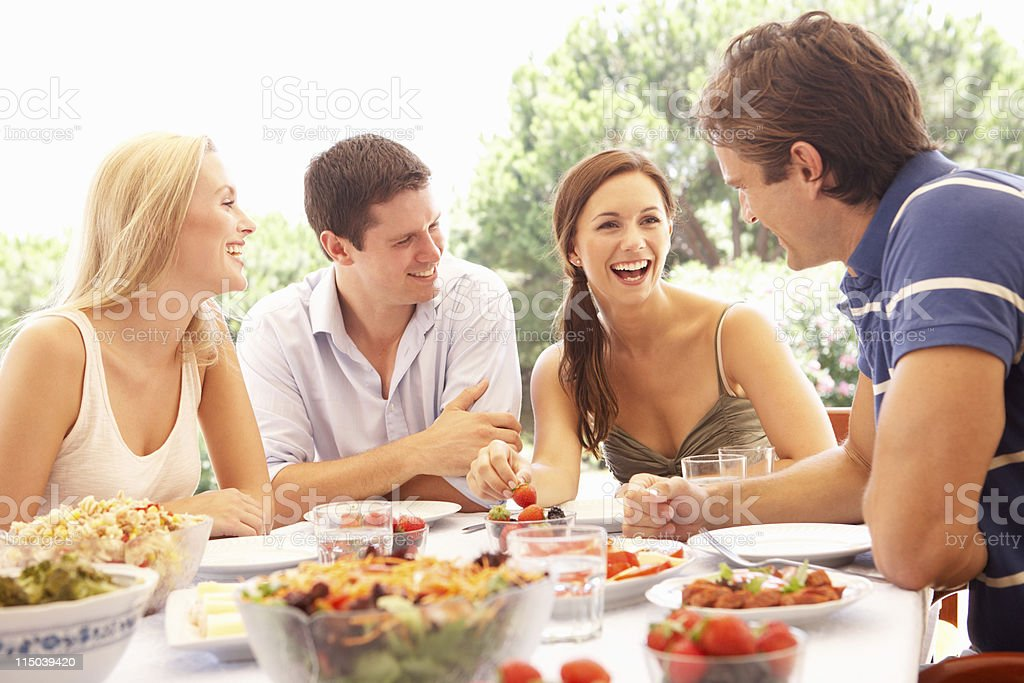 Young couples eating outdoors stock photo