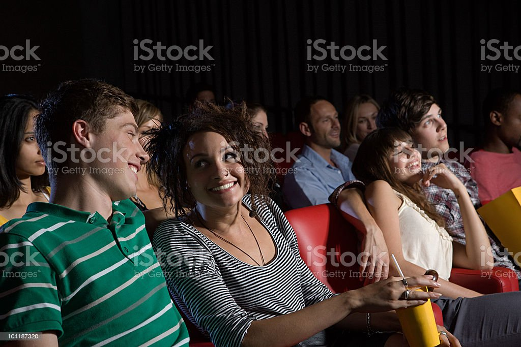 Young couples enjoying a movie royalty-free stock photo