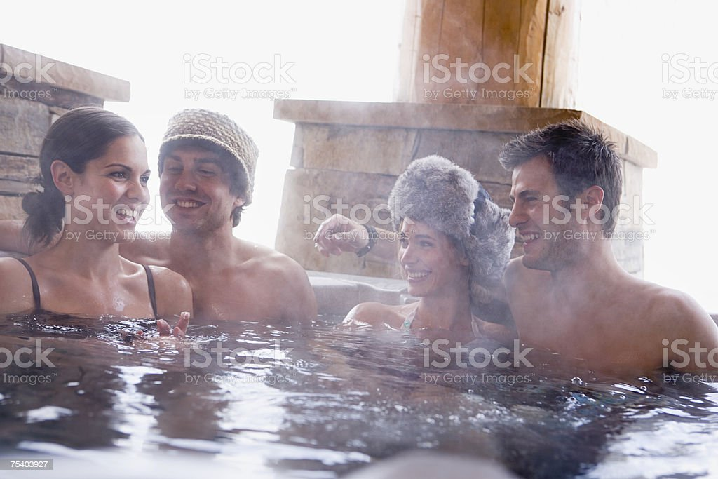 Young couples in a hot tub stock photo
