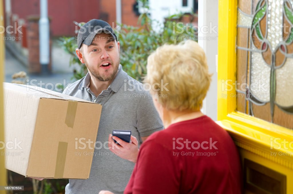 Young courier delivers parcel stock photo