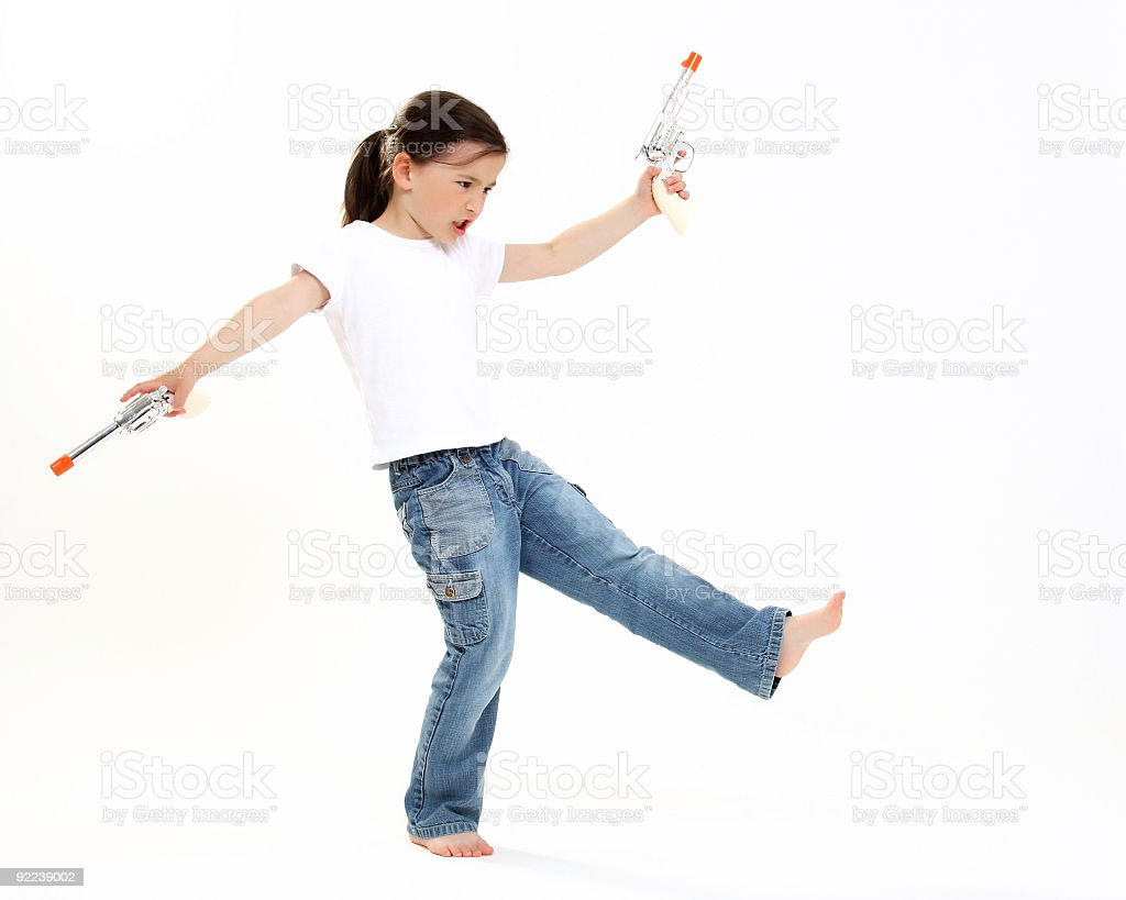 Young cowgirl with a toy gun royalty-free stock photo
