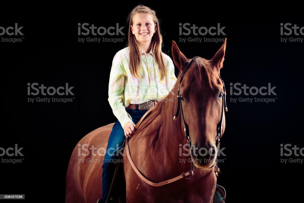 Young Cowgirl With Her Horse stock photo
