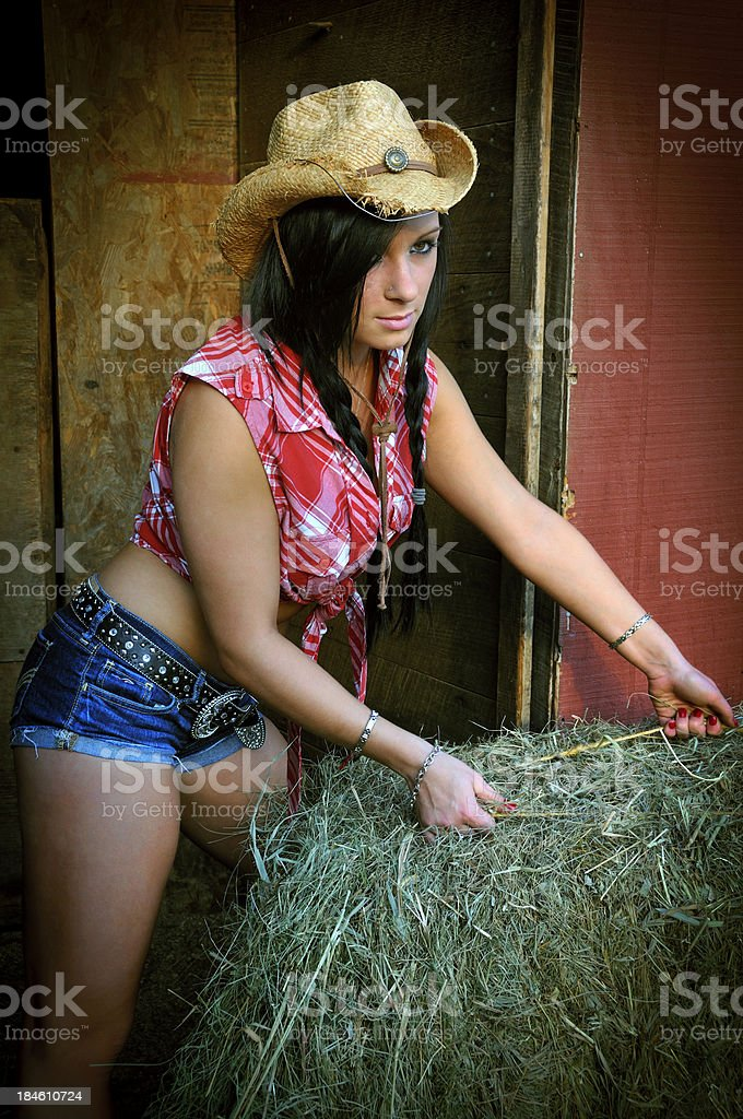 Young Cowgirl Working on the Farm stock photo