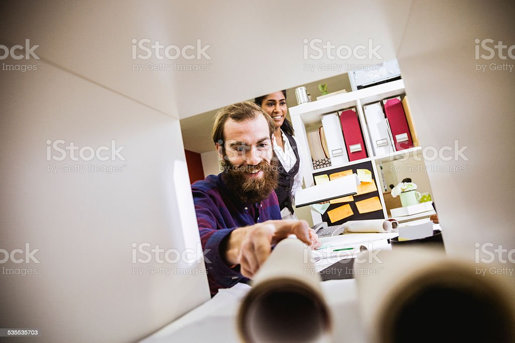 Young creative at work in the office stock photo