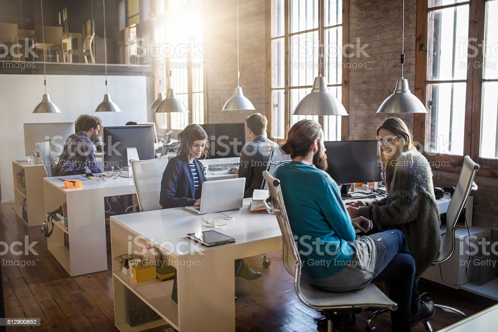 Young creative business people working in the office late in the...