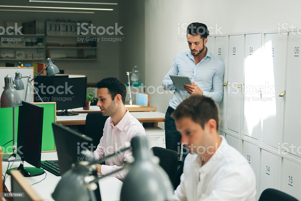 Young Creative Business People Working In Their Office. stock photo