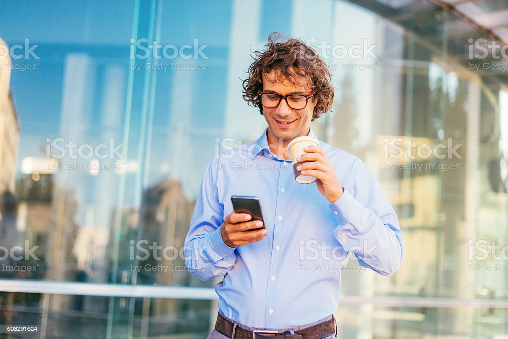 Young creative businessman communicates with online messages stock photo