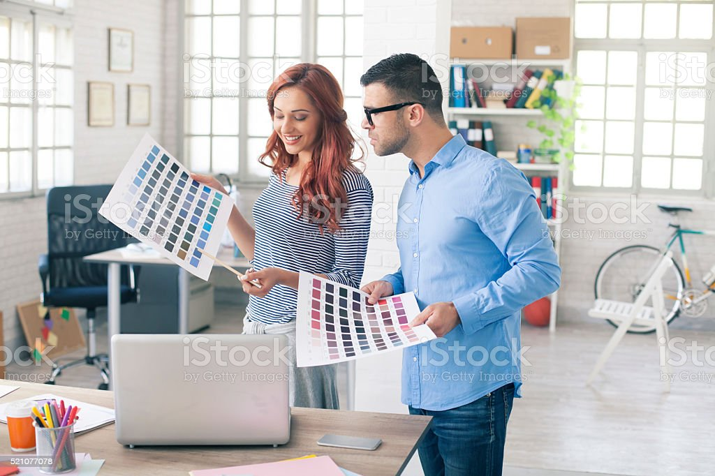 Young creative designers working with color samples stock photo