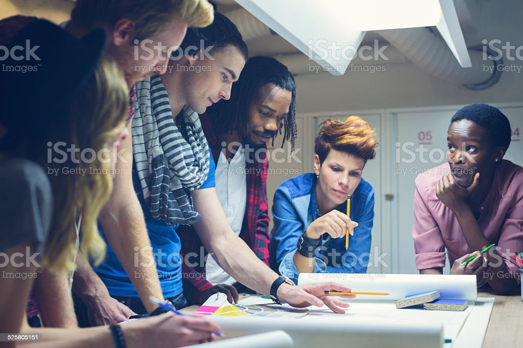 Young Creative People At Work. stock photo