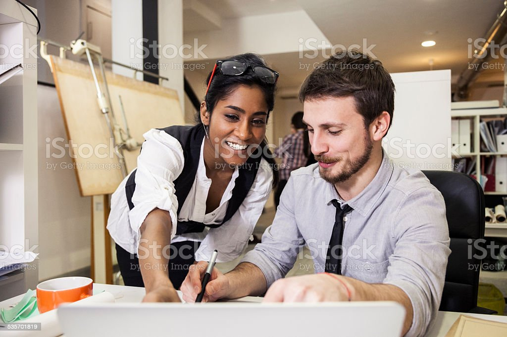 Young creative team at work in the office stock photo